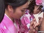 Three geishas sucking on one lonely cock