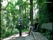 Man stalks a woman in a park